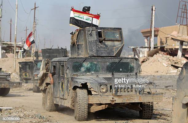 Members of Iraq's elite counterterrorism service parade with their Humvees on December 28 2015 after they recaptured the city of Ramadi the capital...