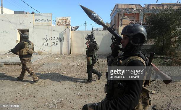 Members of Iraq's elite counterterrorism service patrol on December 29 2015 in the city of Ramadi the capital of Iraq's Anbar province about 110...