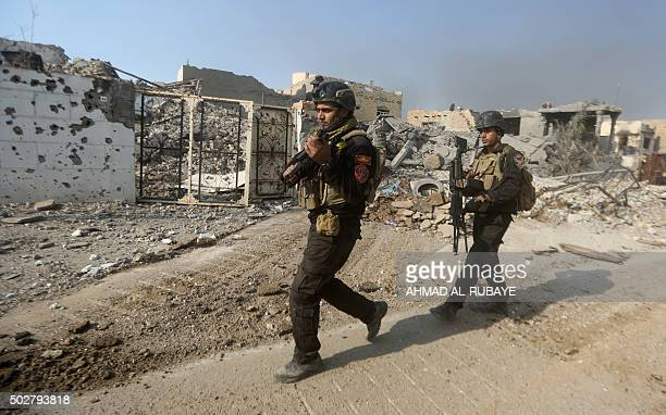Members of Iraq's elite counterterrorism service patrol on December 29 2015 the city of Ramadi the capital of Iraq's Anbar province about 110...