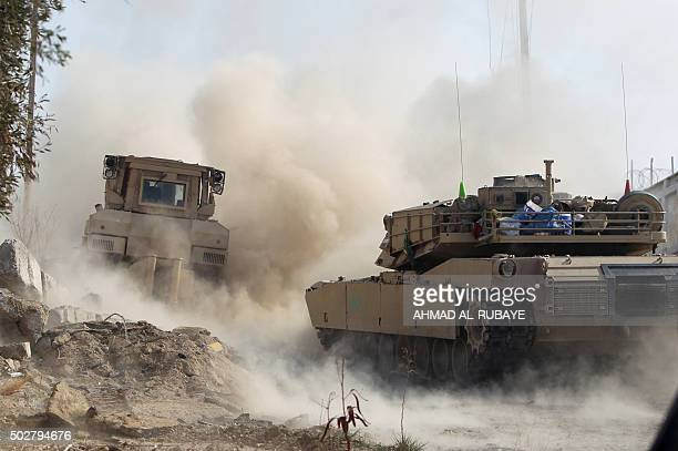 Members of Iraq's elite counterterrorism service use their military vehicles to patrol on December 29 2015 the city of Ramadi the capital of Iraq's...