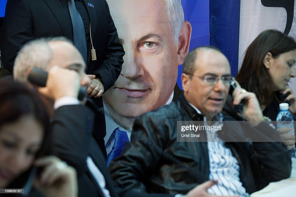 Members of Israeli Prime Minister Benjamin Netanyahu's Likod party speaks with potential voters ahead of the upcoming Israeli elections on January 17, 2013. in Tel Aviv, Israel. Israeli elections are scheduled for January 22 and so far showing a majority for the Israeli right.