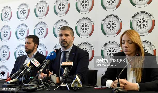 Members of Italy's farright CasaPound movement Luca Marsella CasaPound VicePresident Simone Di Stefano and Carlotta Chiaraluce prepare to speak...