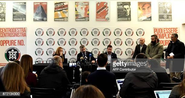 Members of Italy's farright CasaPound movement Luca Marsella CasaPound VicePresident Simone Di Stefano and Carlotta Chiaraluce speak during a press...
