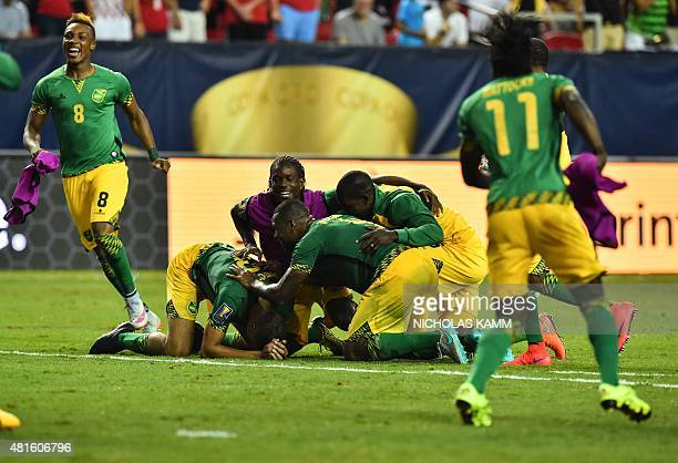 Members of Jamaica's national team celebrate defeating the US 21 in a CONCACAF Gold Cup semifinal football match in Atlanta on July 22 2015 AFP...