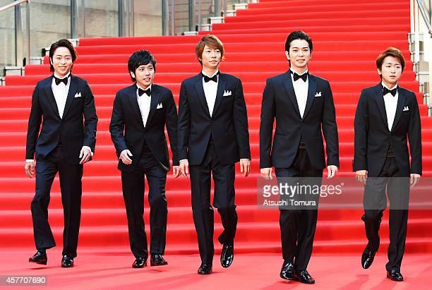 Members of Japanese Boy band Arashi Sho Sakurai Kazunari Ninomiya Masaki Aiba Jun Matsumoto and Satoshi Ono arrives at the opening ceremony during...