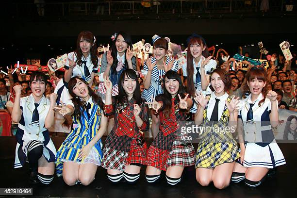 Members of Japanese pop group AKB48 attend a fan meeting on July 29 2014 in Shanghai China