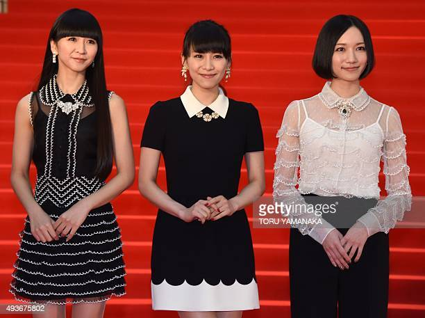 Members of Japanese pop group Perfume Kashiyuka Achan and Nocchi appear before photographers on the red carpet upon their arrival for the opening...