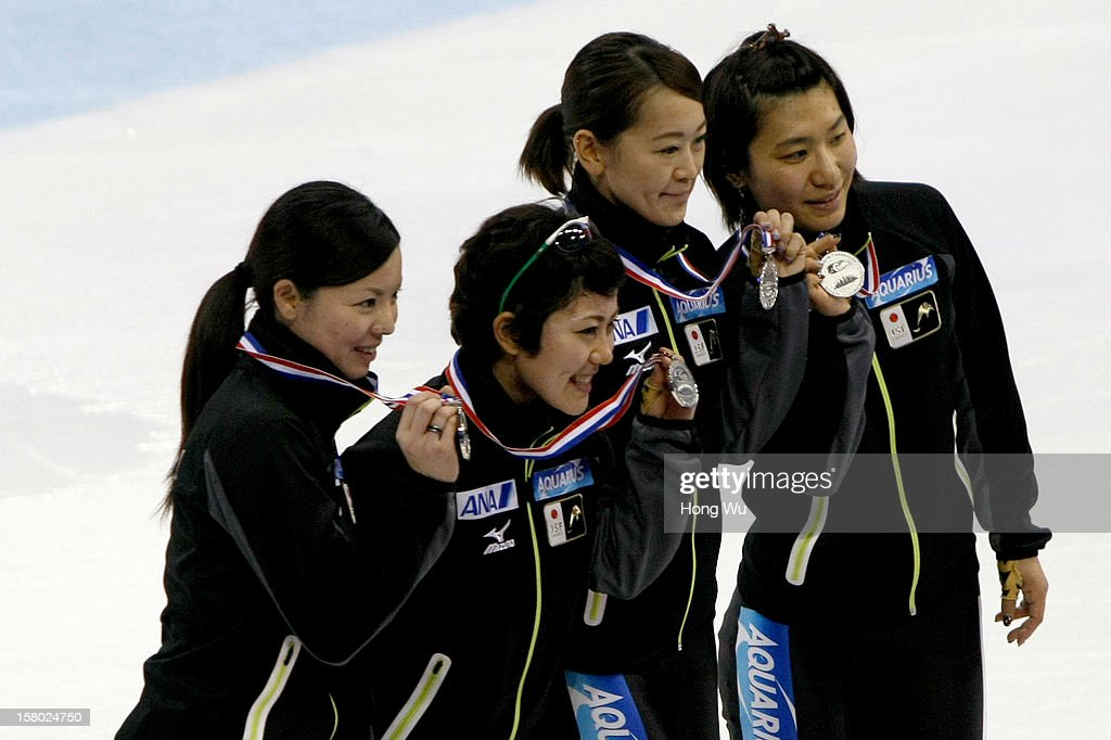 Members of Japanese women's short-track relay team, celebrate after won 2nd Place at ceremony of the Women's 3000m Relay Final during the day two of the ISU World Cup Short Track at the Oriental Sports Center on December 9, 2012 in Shanghai, China.