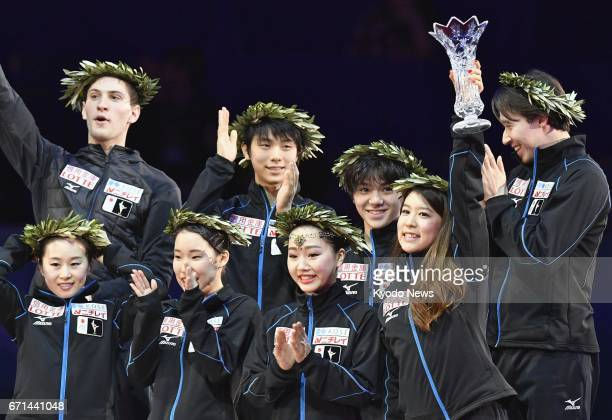 Members of Japan's figure skating team celebrate during the victory ceremony after winning the World Team Trophy in Tokyo on April 22 2017 ==Kyodo