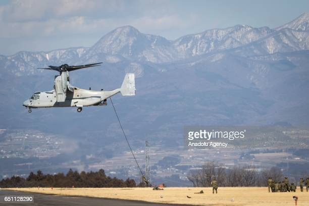 Members of Japan's Self Defence Forces is seen rappelling from a MV22 Osprey during the USJapan joint training drill in JGSDF Camp Soumagahara Gunma...
