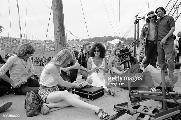 Members of Jefferson Airplane sit with promoter Bill Graham and musician Country Joe McDonald at the free Woodstock Music and Art Fair The festival...