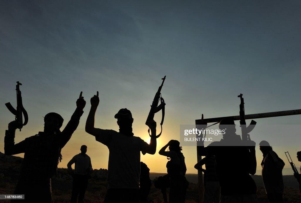 Members of Jihadist group Hamza Abdualmuttalib train near Aleppo on July 19 2012 Rebels seized control of all of Syria's border crossings with Iraq...