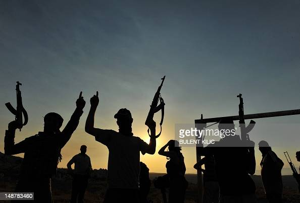 Members of Jihadist group Hamza Abdualmuttalib train near Aleppo on July 19 2012 Rebels seized control of all of Syria's border crossings with Iraq...