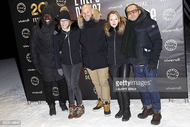 Members of Jury Omar Sy Pascale Arbillot Franck Gastambide Audrey Lamy and Patrick Timsit attend the Photocall 'Le Jamel Comedy Club prend de...