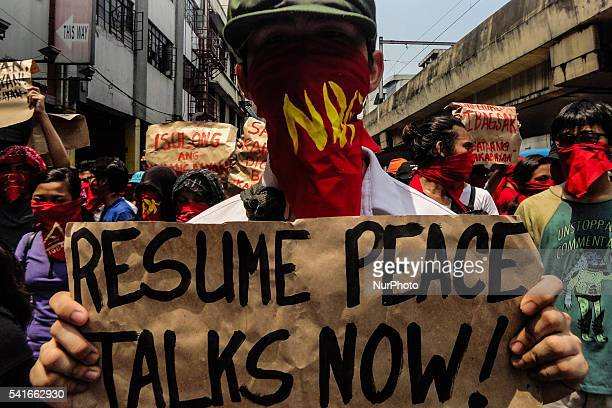 Members of Kabataang Makabayan a youth group affiliated with the National Democratic Front of the Philippines hold a rally in Manila Philippines on...
