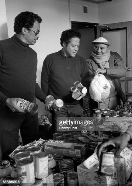 Members of Kappa Alpha Psi Fraternity get ready to distribute food to the needy for their Christmas project l to r Webb Tarrant Jim Lyday and William...
