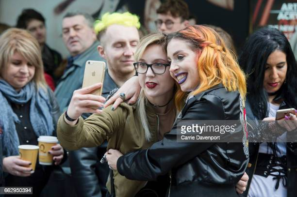 members of Kat Von D's Artistry Collective pose with fans waiting to meet Kat at Debenhams Henry Street>> on April 1 2017 in Dublin Ireland