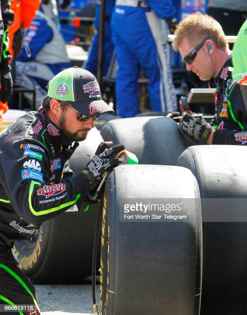 Members of Kyle Busch's crew inspect tires after a pit stop in the Monster Energy NASCAR Cup O'Reilly Auto Parts 500 on Sunday April 9 2017 at Texas...