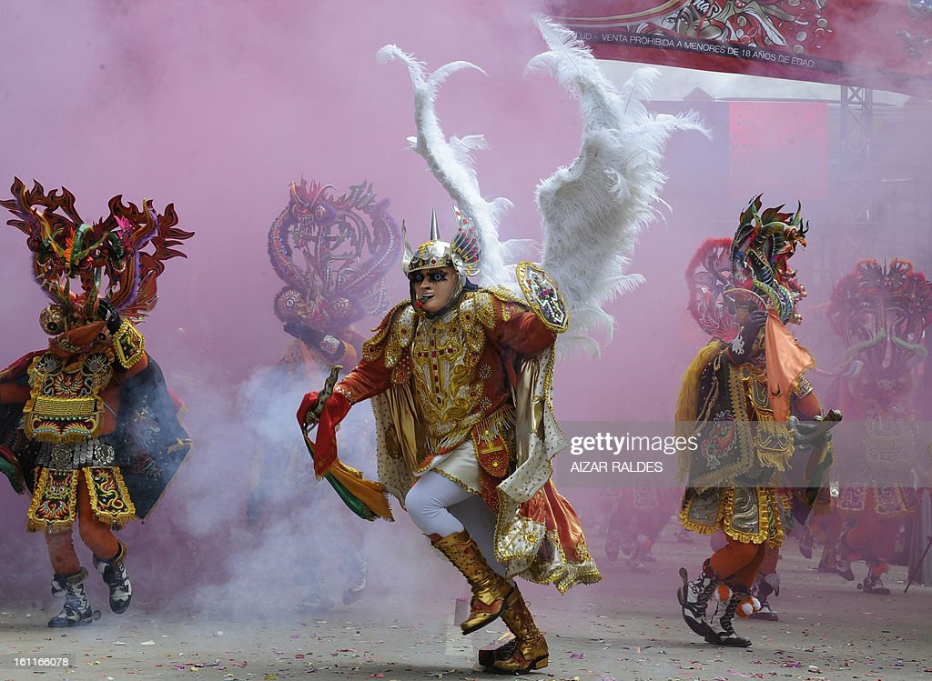 Members of La Diablada (Dance of the Devils) dance troupe take part in Carnival of Oruro, in the mining town of Oruro, 240 km south of La Paz on February 9, 2013. The Carnival of Oruro was inscribed by UNESCO on the Representative List of the Intangible Cultural Heritage of Humanity in 2008. AFP PHOTO/AIZAR RALDES