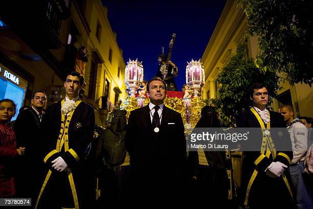 Members of 'Las Penas' brotherhood walk during their procession on April 2 2007 in Seville Southern Spain The Holy Week of Seville is the staging of...