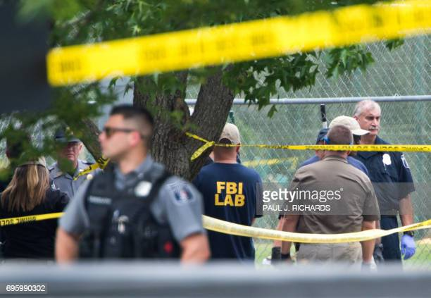 Members of law enforcement gather at the crime scene after a shooting in Alexandria Virginia on June 14 2017 Several people including a top...