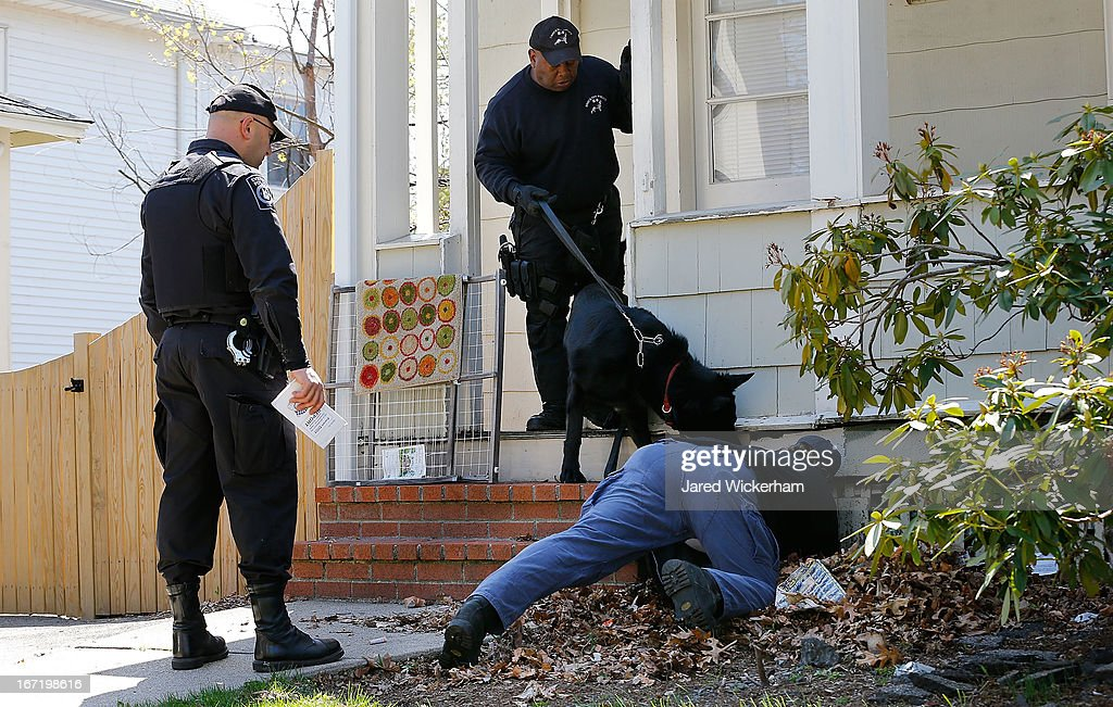 Members of law enforcement, including K-9 units, investigate the scene while executing a second sweep of the area around Franklin Street on April 22, 2013 in Watertown, Massachusetts. A manhunt ended for Dzhokhar A. Tsarnaev, 19, a suspect in the Boston Marathon bombing after he was apprehended on a boat parked on a residential property in Watertown, Massachusetts. He has been charged with one count of using a weapon of mass destruction and one count of malicious destruction of property by means of an explosive device resulting in death. His brother Tamerlan Tsarnaev, 26, the other suspect, was shot and killed after a car chase and shootout with police. The bombing, on April 15 at the finish line of the marathon, killed three people and wounded at least 170.