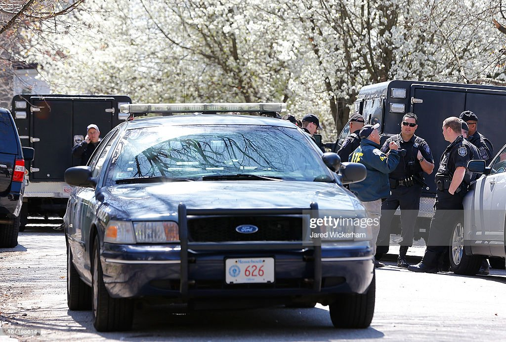 Members of law enforcement investigate the scene while executing a second sweep of the area around Franklin Street on April 22 2013 in Watertown...