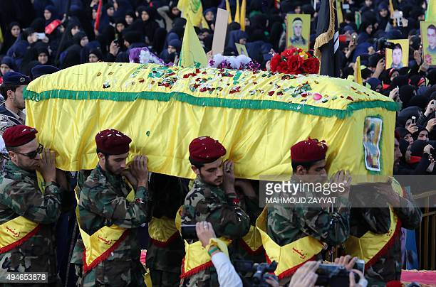 Members of Lebanon's powerful Shiite movement Hezbollah carry the coffin of a comrade who was killed during battles in Syria's northern city of...