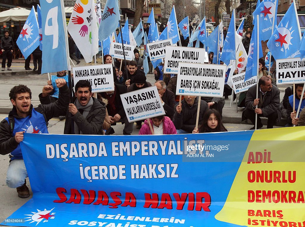 Members of leftist political parties hold banners that read 'we are against the war inside and outside the country' during a protest against NATO's Patriot missiles stationed near the border with Syria, in Ankara, on February 23, 2013.