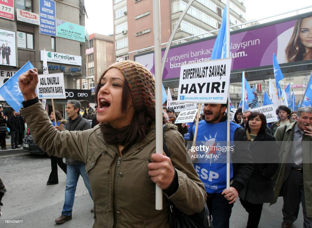 Members of leftist political parties take part in a protest against NATO's Patriot missiles stationed near the border with Syria, in Ankara, on February 23, 2013. AFP PHOTO/ADEM ALTAN