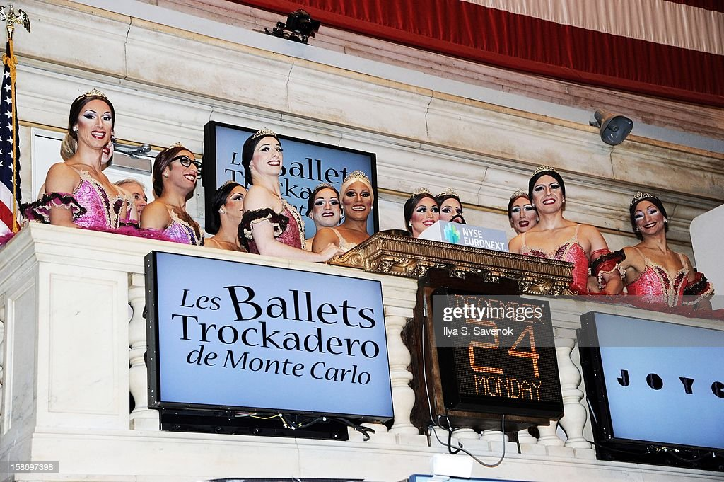 Members of Les Ballets Trockadero de Monte Carlo ring the opening bell at the New York Stock Exchange on December 24, 2012 in New York City.
