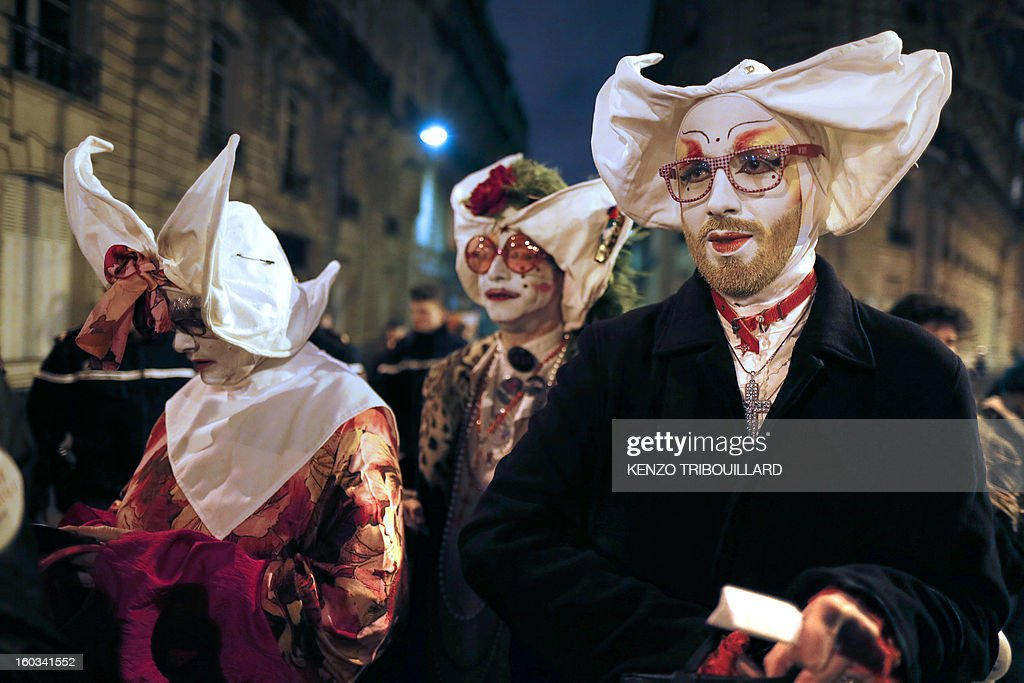 Members of 'Les Soeurs de la Perpetuelle Indulgence' (Sisters of Perpetual Indulgence) walk in the streets near the French National Assembly in Paris on January 29, 2013 as France's parliament examined a draft legislation on same-sex marriage after months of rancorous debate and huge street protests by both supporters and opponents. AFP PHOTO / KENZO TRIBOUILLARD