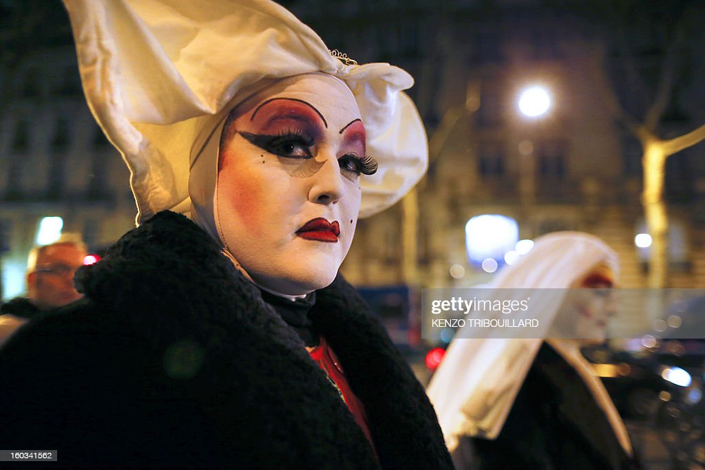 Members of 'Les Soeurs de la Perpetuelle Indulgence' (Sisters of Perpetual Indulgence) walk in the streets near the French National Assembly in Paris on January 29, 2013 as France's parliament examined a draft legislation on same-sex marriage after months of rancorous debate and huge street protests by both supporters and opponents.