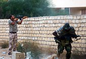 Members of Libya's Shield Brigade clash with gunmen accused of being loyal to the former regime of slain dictator Moamar Kadhafi on September 16 in...
