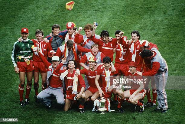 Members of Liverpool FC celebrate with the FA Cup trophy after their 31 victory over Everton in the FA Cup Final at Wembley Stadium London on 10th...