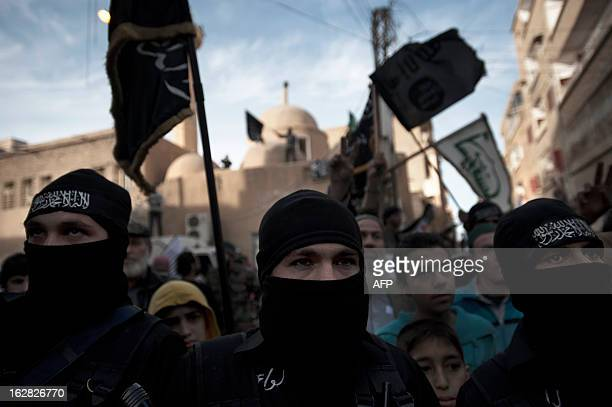 Members of Liwa Hamzah a newly formed Islamist brigade from the Syrian eastern city of Deir Ezzor take part in a rally in the centre of the city to...