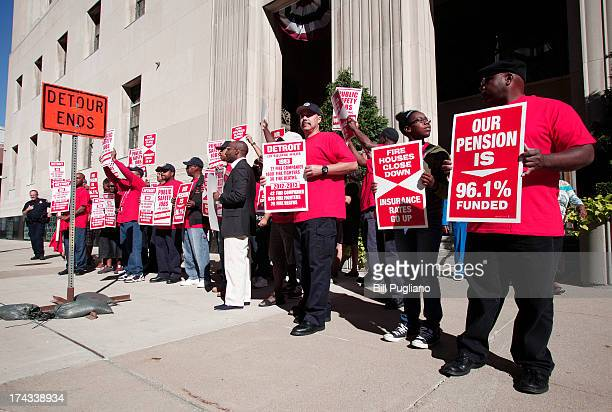Members of Local 334 of the Detroit Firefighters Association protest outside during the City of Detroit's bankruptcy hearing at the US Courthouse...