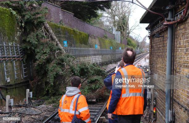 Members of London Underground's Emergency Response Unit prepare to remove an uprooted tree that blocked the track at Colindale Underground Station in...