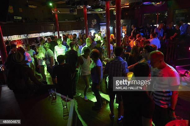 Members of London's LGBT community enjoy an evening out at the Royal Vauxhall Tavern in south London on July 18 2015 London is one of the world's...