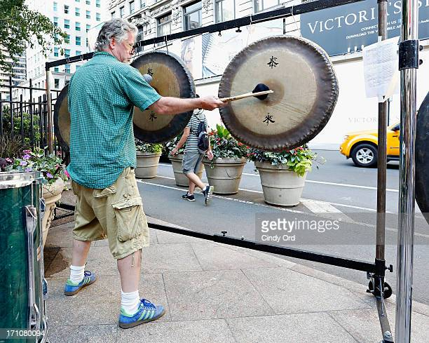 Members of Loop 243 perform as Gongs Ring In the Evening on Longest Day Of the Year National Music Day During Make Music NY in Herald Square on June...