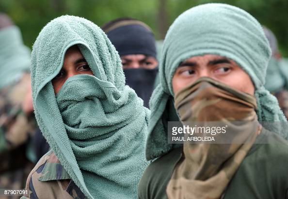 Members of 'Los Rastrojos' bandit group cover their faces with towels and bandannas as they surrender at the Voltigeros Battalion on May 21 2009 in...