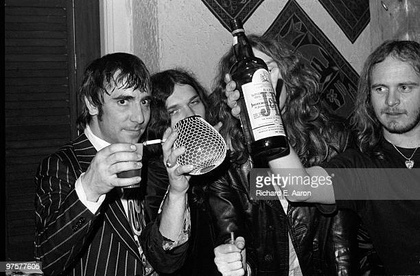 Members of Lynyrd Skynyrd posed with Keith Moon from The Who at a party for Lynyrd Skynyrd at Nathans in New York on October 23 1976 LR Keith Moon...