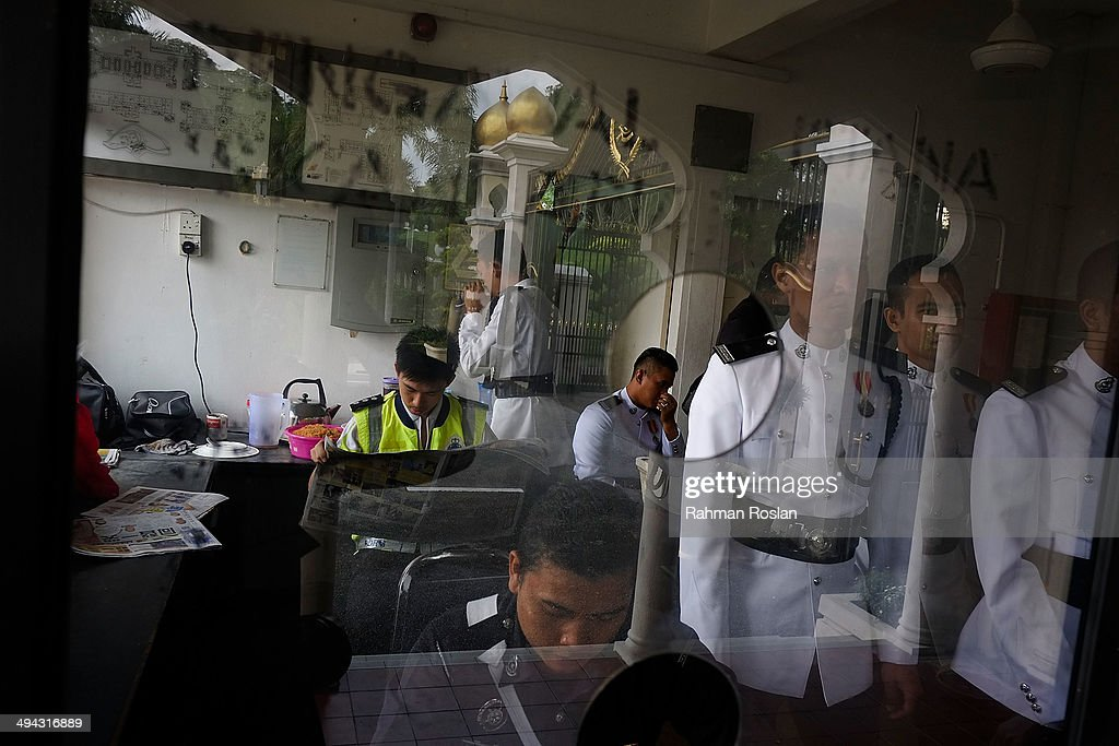 Members of Malaysian Armed Forces rest in a shelter while taking a break during Sultan Azlan Shah's royal burial ceremony on May 29 2014 in Kuala...