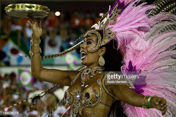 Members of Mangueira dance during the samba school's parade of Rio de Janeiro's carnival at Marques de Sapucai on February 21 2012 in Rio de Janeiro...