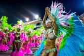 Members of Mangueira Samba School celebrate during their parade at 2014 Brazilian Carnival at Sapucai Sambadrome on March 02 2014 in Rio de Janeiro...