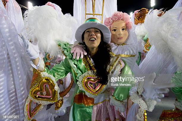 Members of Mangueira Samba School perform during the parade themed on Cuiaba capital city of Mato Grosso at Sambodrome Sapucai as part of Carnival...