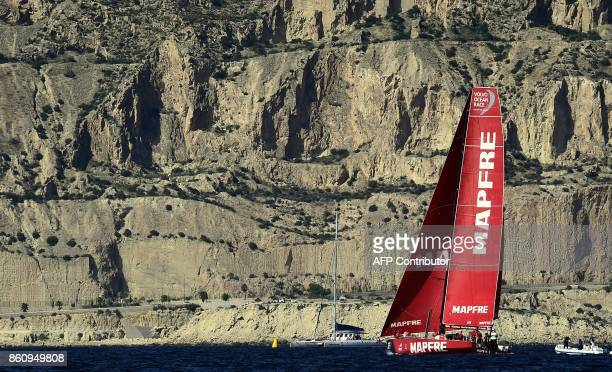Members of MAPFRE sail on October 13 2017 off the coast of Alicante southeastern Spain during a training for the next Volvo Ocean Race a yacht race...