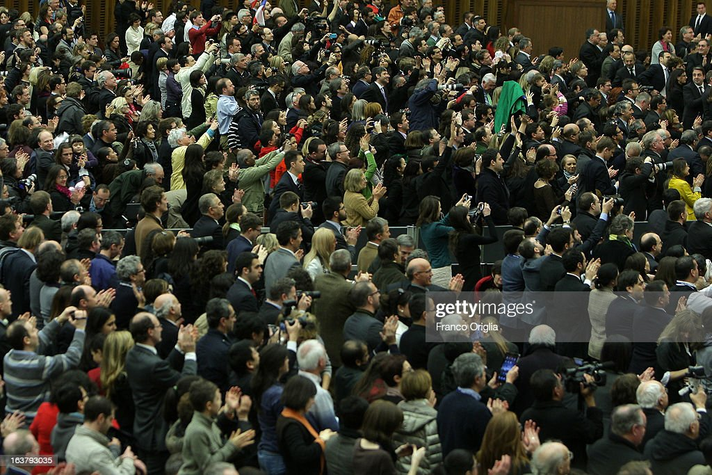 Members of media from around the world greet newly elected Pope Francis during his first audience with journalists and media inside the Paul VI hall on March 16, 2013 in Vatican City, Vatican. The pope thanked the media for their coverage during the historic transition of the papacy and explained his vision of the future for the Catholic Church.