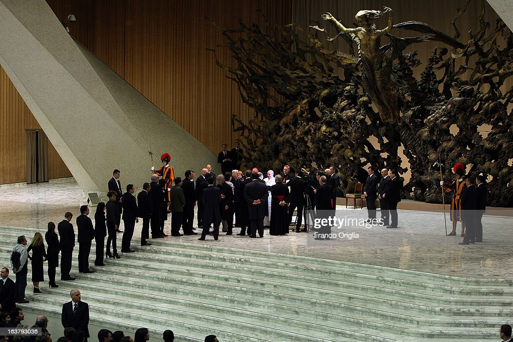 Members of media from around the world greet newly elected <a gi-track='captionPersonalityLinkClicked' href=/galleries/search?phrase=Pope+Francis&family=editorial&specificpeople=2499404 ng-click='$event.stopPropagation()'>Pope Francis</a> during his first audience with journalists and media inside the Paul VI hall on March 16, 2013 in Vatican City, Vatican. The pope thanked the media for their coverage during the historic transition of the papacy and explained his vision of the future for the Catholic Church.