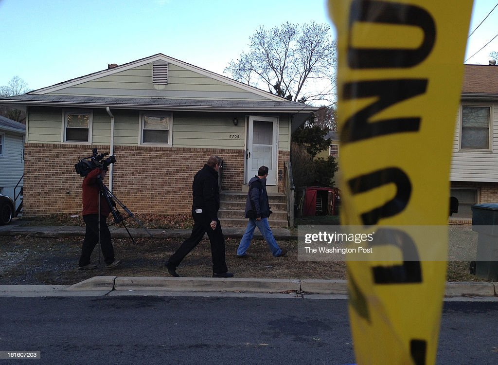 Members of media pass crime scene on 36th Ave where Two University of Maryland students died in a murder/suicide and a third suffered gun shot injuries early Tuesday February 12, 2013 in College Park, Maryland. The three lived in this home at 8706 36th Avenue in College Park.